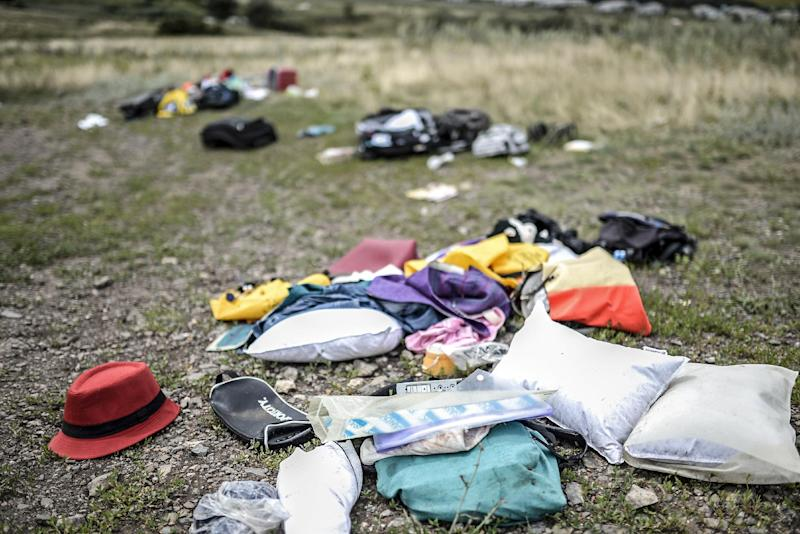Belongings are scattered at the crash site of a Malaysia Airlines plane in Grabove on July 20, 2014 (AFP Photo/Bulent Kilic)