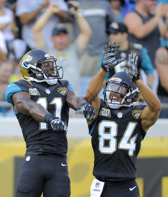 Jacksonville Jaguars wide receiver Marqise Lee (11) celebrates a 57-yard touchdown reception against the Atlanta Falcons with teammate wide receiver Cecil Shorts (84) during the first half of an NFL preseason football game in Jacksonville, Fla., Thursday, Aug. 28, 2014. (AP Photo/Stephen B. Morton)