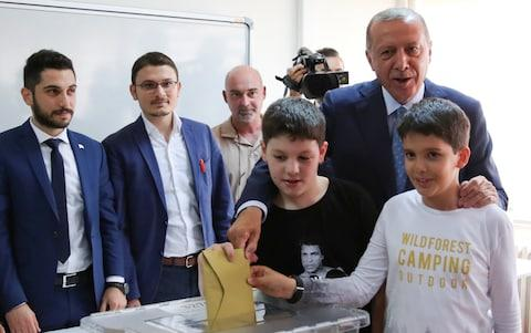 President Recep Tayyip Erdogan votes with his grandchildren in Istanbul - Credit: REUTERS/Umit Bektas