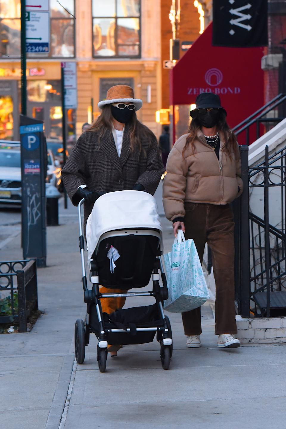 The model (left) takes her daughter for a walk around New York's SoHo with a friend.  (Getty Images)