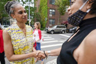 Democratic mayoral candidate Maya Wiley, left, greets a voter during a campaign stop near a polling place in the West Village neighborhood of New York, Tuesday, June 22, 2021. (AP Photo/Mary Altaffer)