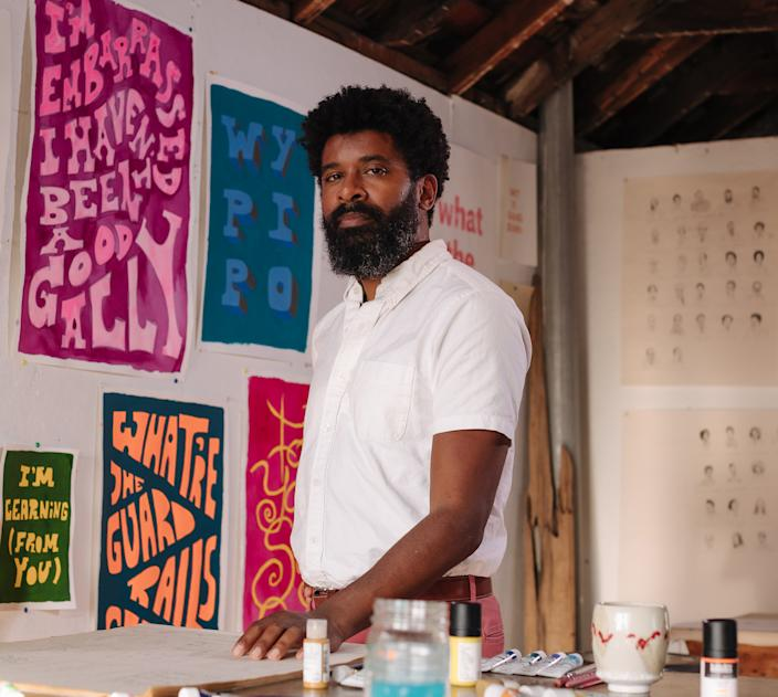 George McCalman, in his fine art studio, along with work made for his show, 'Tell Me Three Things I Can Do / Return To Sender'. (Peter Prato)