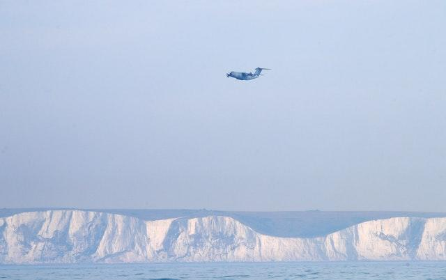 A view of a Royal Air Force Atlas A400M aeroplane in the skies above Dover in Kent (Gareth Fuller/PA)