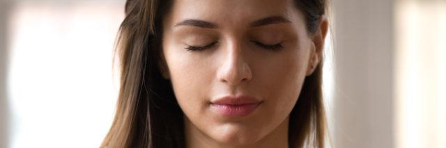 Woman with eyes closed and looking peaceful