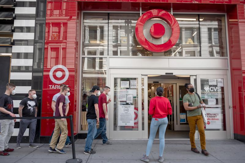 NEW YORK, NEW YORK - MAY 16: People wearing masks avoid social distancing as they wait in line to enter Target in Herald Square amid the coronavirus pandemic on May 16, 2020 in New York City. COVID-19 has spread to most countries around the world, claiming over 312,000 lives with over 4.7 million cases. (Photo by Alexi Rosenfeld/Getty Images)