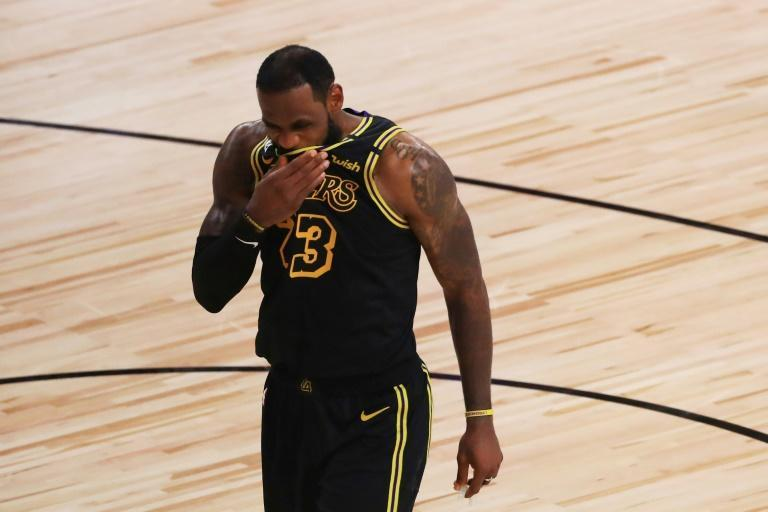 LeBron James of the Los Angeles Lakers reacts in the fourth quarter of his team's 111-108 loss to the Miami Heat in game five of the NBA Finals
