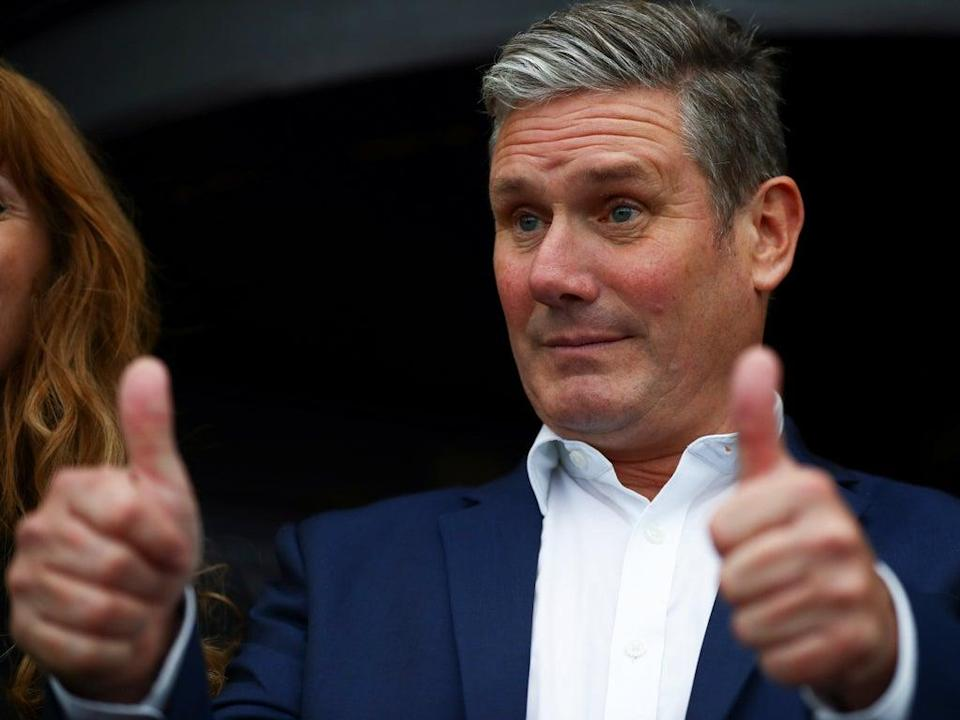 Keir Starmer puts on a brave face as he arrives at the Labour Conference in Brighton (Hannah McKay/Reuters)
