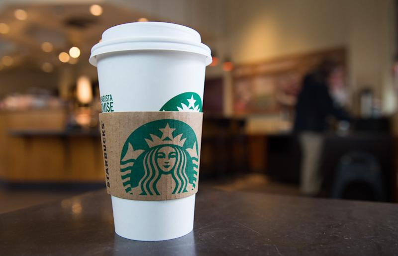 A Starbucks coffee cup is seen inside a Starbucks Coffee shop in Washington, DC, April 17, 2018, following the company's announcement that they will close more than 8,000 US stores on May 29 to conduct