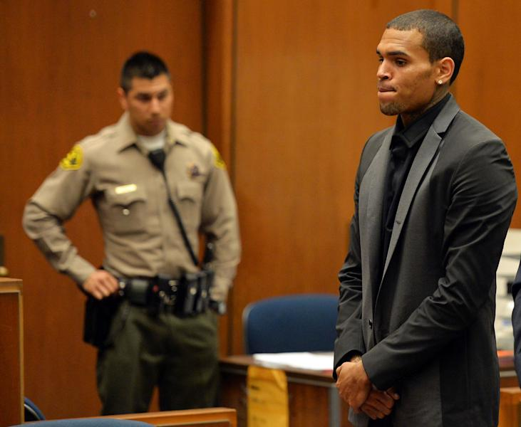 R&B singer Chris Brown appears during a court hearing at Los Angeles Superior court in Los Angeles Monday, July 15, 2013. A Los Angeles judge has revoked Chris Brown's probation after reading details of an alleged hit-and-run accident and his behavior afterward, but the singer was not ordered to jail. The prosecutor did not ask for Brown to be jailed. Another hearing is set for Aug. 16. The singer has been on felony probation in the 2009 beating of former girlfriend Rihanna. (AP Photo/Alberto E. Rodriguez, Pool)
