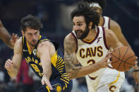 Cleveland Cavaliers' Ricky Rubio (3) drives past Indiana Pacers' T.J. McConnell (9) in the first half of an NBA basketball preseason game, Friday, Oct. 8, 2021, in Cleveland. (AP Photo/Tony Dejak)