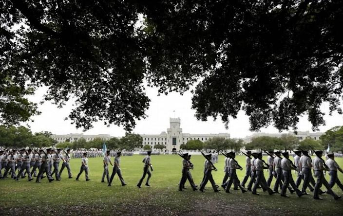 Citadel cadets practice for their weekly parade on the grounds of Summerall Field on the campus of The Citadel in Charleston, S.C.