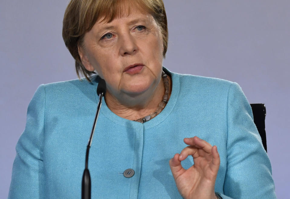 """German Chancellor Angela Merkel speaks at a press conference at the Chancellery in Berlin, Wednesday June 3, 2020, after coalition meetings. Germany's governing parties agreed on a 130 billion euro ($146 billion) stimulus package Wednesday meant to help kick-start Europe's biggest economy, which has taken a heavy hit from the coronavirus pandemic. Following two days of talks in Berlin, Chancellor Angela Merkel said the package was a """"bold response"""" that would boost consumption and investment and ease the strain on families and others. (John MacDougall/Pool via AP)"""