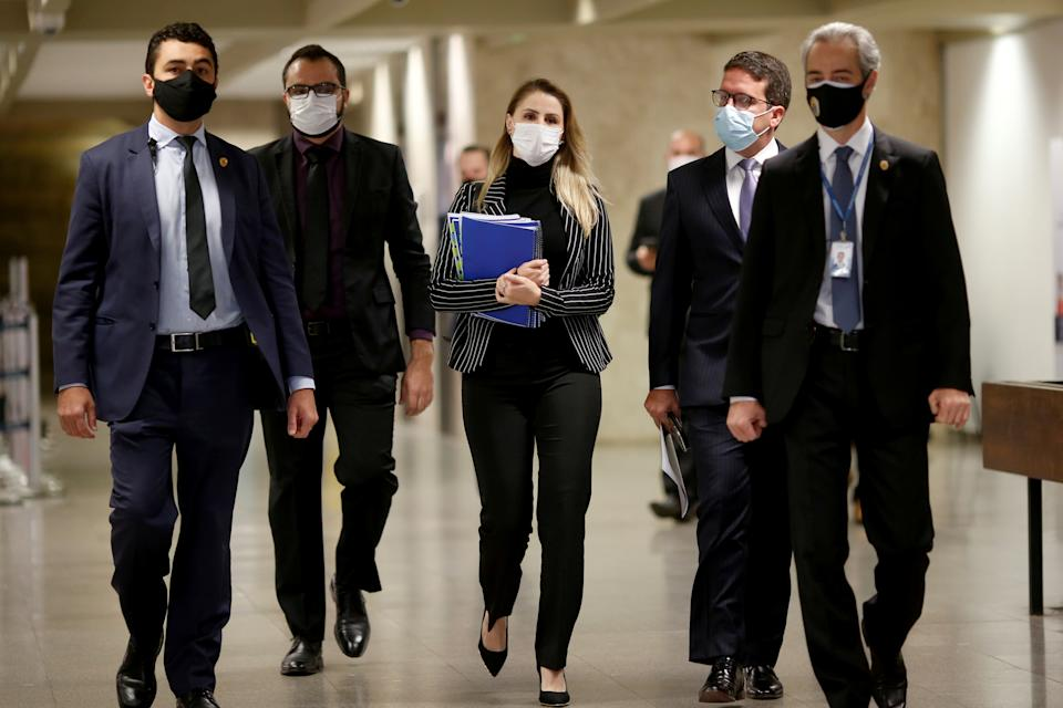 Former employee of the Ministry of Health, Francieli Fantinato, walks before a meeting of the Parliamentary Inquiry Committee (CPI) to investigate government actions and management during the coronavirus disease (COVID-19) pandemic, at the Federal Senate in Brasilia, Brazil July 8, 2021. REUTERS/Adriano Machado REFILE - CORRECTING NAME