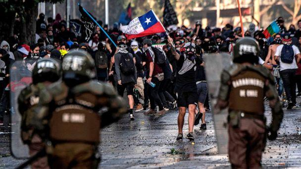 PHOTO:Demonstrators clash with riot police during protests in Santiago, Oct. 29, 2019. (Pedro Ugarte/AFP/Getty Images)