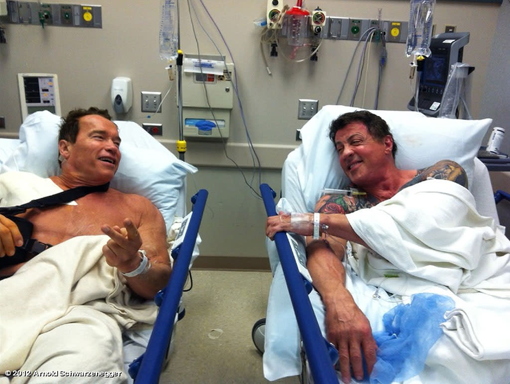 "No, Arnold Schwarzenegger and Sylvester Stallone aren't shooting a scene for a movie about 60something former action stars who forge a friendship in a nursing home. The two happened to bump into each other in the hospital as they both got ready to have shoulder surgeries and Schwarzenegger decided to post this pic to his <a target=""_blank"" href=""http://www.whosay.com/arnoldschwarzenegger"">WhoSay</a> page on Wednesday. ""After all the action, stunts & physical abuse shooting The Expendables 2 and The Last Stand, it was time for a little tune up on my shoulder,"" Schwarzenegger -- who'll be starring in upcoming action flick ""The Tomb"" with Sly -- wrote. ""Look who was coincidentally waiting in line behind me for his shoulder surgery. Now we're ready for another round of great times and action when we shoot The Tomb. #greattobeback"""