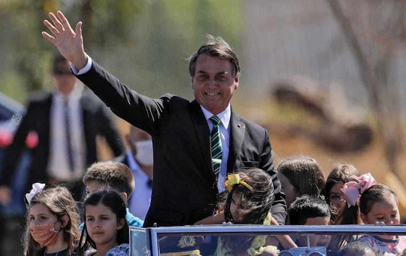 Brazil's President Jair Bolsonaro gestures from a car during Independence Day celebrations in Brasilia, on September 7, 2020 amid the COVID-19 novel coronavirus pandemic. - Bolsonaro commemorated Brazil's 198th anniversary of independence in a day in which demonstrations for and against his government are expected. (Photo by Sergio LIMA / AFP) (Photo by SERGIO LIMA/AFP via Getty Images)