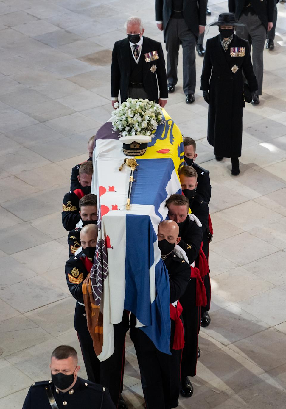Pall Bearers carrying the coffin of the Duke of Edinburgh, followed by the Prince of Wales (left), Princess Anne (right) in St George's Chapel, Windsor Castle, Berkshire. Picture date: Saturday April 17, 2021.