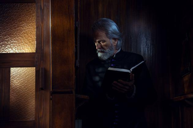 Senior priest in confession booth (Photo: D-Keine via Getty Images)