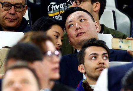 David Han Li sits in the tribune during the Juventus vs Barcelona UEFA Champions League soccer match in Turin, Italy April 11, 2017. Picture taken on April 11, 2017. REUTERS/Alessandro Bianchi