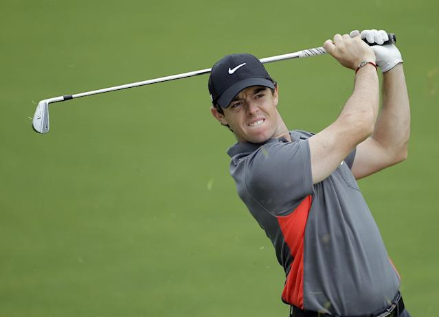 Rory McIlroy grimaces as he hits from the fairway to 16th green during the pro-am of the Wells Fargo Championship golf tournament at Quail Hollow Club in Charlotte, N.C., Wednesday, April 30, 2014. (AP Photo/Bob Leverone)