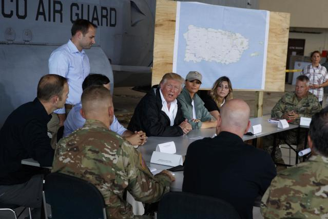 <p>President Donald Trump and first lady Melania Trump participate in a briefing on hurricane recovery efforts with first responders at Luis Muniz Air National Guard Base, Tuesday, Oct. 3, 2017, in San Juan, Puerto Rico. (Photo: Evan Vucci/AP) </p>