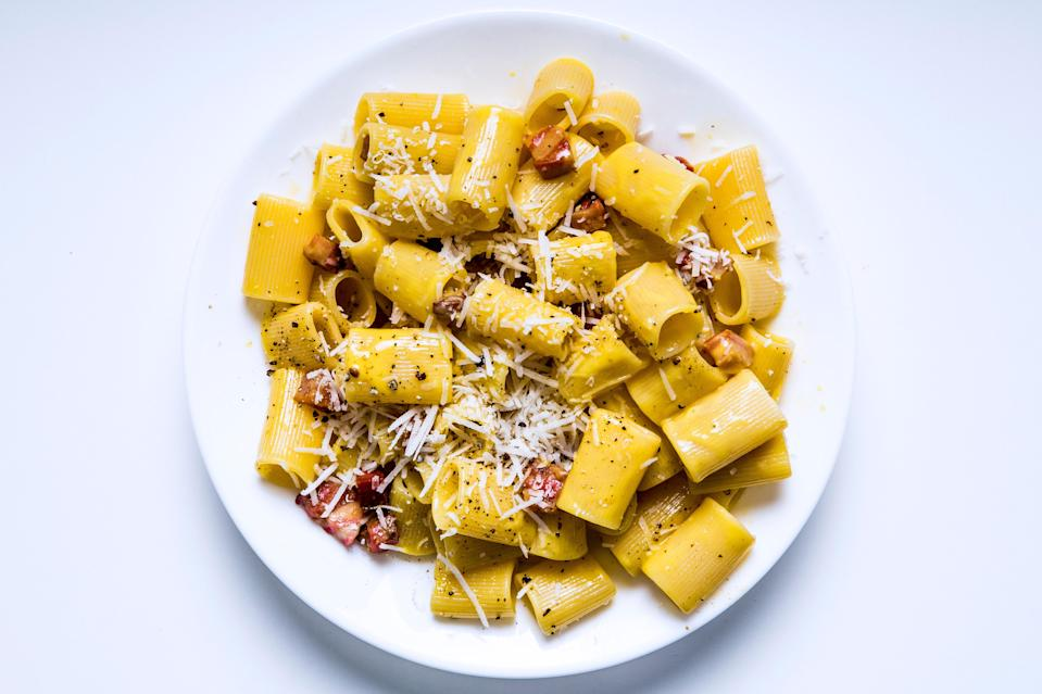 """In Rome, chef Barbara Lynch ate the perfect carbonara: The sauce was bright yellow from fresh eggs, and each rigatoni hid cubes of fatty guanciale. This is her recipe. <a href=""""https://www.bonappetit.com/recipe/the-silkiest-carbonara?mbid=synd_yahoo_rss"""" rel=""""nofollow noopener"""" target=""""_blank"""" data-ylk=""""slk:See recipe."""" class=""""link rapid-noclick-resp"""">See recipe.</a>"""