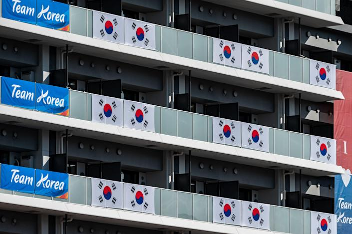South Korea flags and signage are displayed at the Olympic and Paralympic Village in Tokyo on July 15, 2021, ahead of the 2020 Tokyo Olympic Games which begins on July 23.