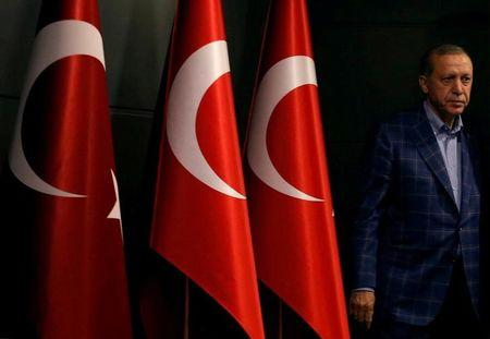 FILE PHOTO: Turkish President Erdogan arrives at a news conference in Istanbul