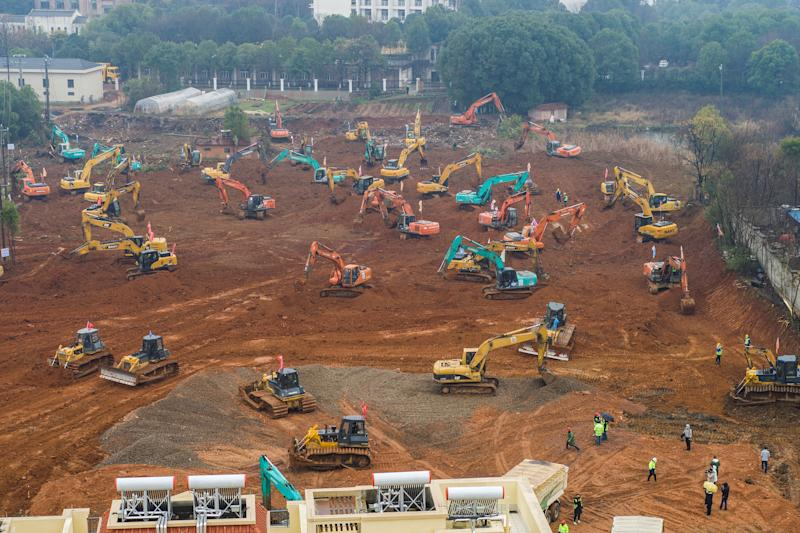 An aerial photo shows excavators at the construction site of a new hospital being built to treat patients from a deadly virus outbreak in Wuhan in China's central Hubei province.
