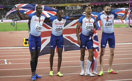 Athletics - World Athletics Championships – men's 4 x 400 metres relay final – London Stadium, Britain – August 13, 2017 – Matthew Hudson-Smith, Dwayne Cowan, Rabah Yousif and Martyn Rooney of Britain celebrate winning the bronze medal. REUTERS/Toby Melville