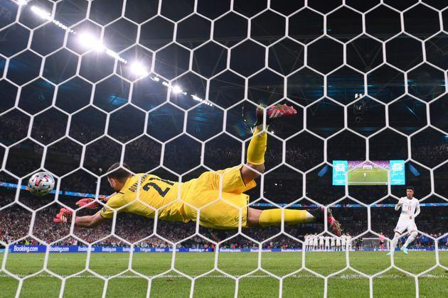 LONDON, ENGLAND - JULY 11: Jadon Sancho of England has their team's fourth penalty saved by Gianluigi Donnarumma of Italy in a penalty shoot out during the UEFA Euro 2020 Championship Final between Italy and England at Wembley Stadium on July 11, 2021 in London, England. (Photo by Laurence Griffiths/Getty Images) (Photo: Laurence Griffiths via Getty Images)