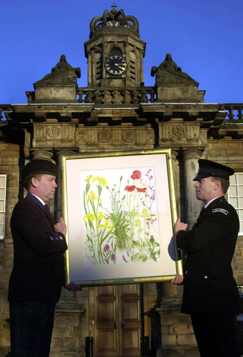 A painting by Dame Elizabeth Blackadder is carried in to the Palace of Holyroodhouse after she was appointed Her Majesty's Painter and Limner (Ben Curtis/PA) (PA Archive)
