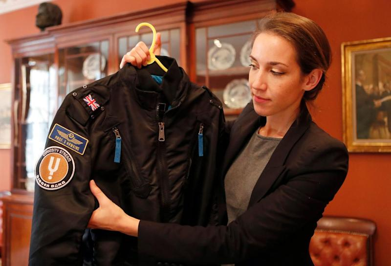 A bomber jacket given to Stephen Hawking is one of the personal and academic possessions at the Christie's auction (Frank Augstein/AP)