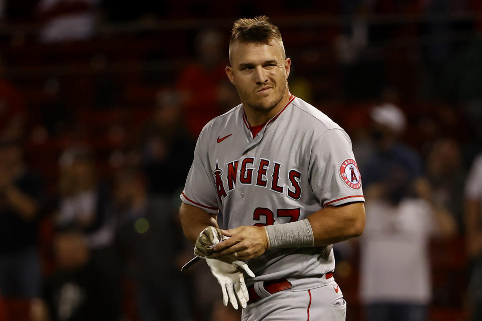 Los Angeles Angels' Mike Trout looks toward the dugout after striking out during the eighth inning of a baseball game against the Boston Red Sox, Friday, May 14, 2021, at Fenway Park in Boston. (AP Photo/Winslow Townson)