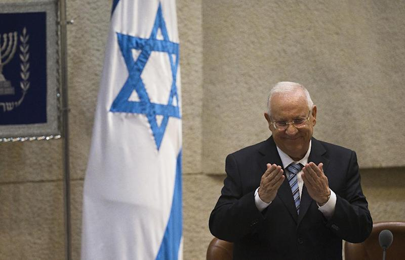 Israeli President Reuven Rivlin gestures during a ceremony at the Knesset, Israel's parliament, in Jerusalem on July 24, 2014