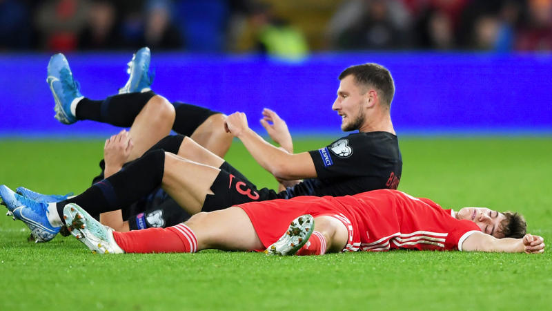 Daniel James of Wales lies on the ground after colliding with Borna Barisic of Croatia during the UEFA Euro 2020 qualifier between Wales and Croatia at Cardiff City Stadium. (Photo by Alex Davidson/Getty Images)