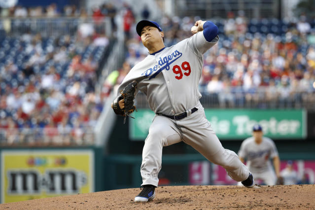 Los Angeles Dodgers starting pitcher Hyun-Jin Ryu, of South Korea, throws to the Washington Nationals in the first inning of a baseball game, Friday, July 26, 2019, in Washington. (AP Photo/Patrick Semansky)
