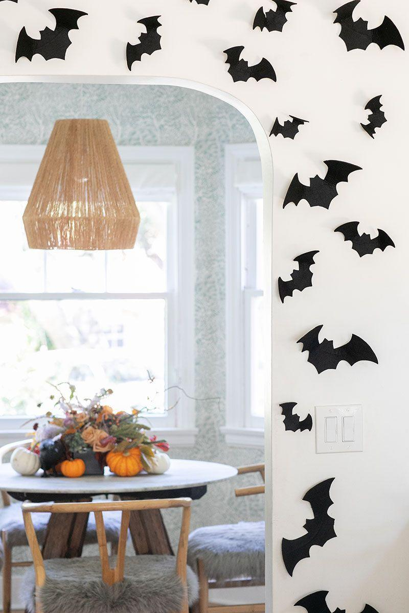 "<p>Frame a doorway with flying paper bats for a super simple but fun Halloween vibe at home. Learn how from <a href=""https://sugarandcharm.com/inexpensive-halloween-decorating-ideas"" rel=""nofollow noopener"" target=""_blank"" data-ylk=""slk:Sugar and Charm"" class=""link rapid-noclick-resp"">Sugar and Charm</a>. </p><p><a class=""link rapid-noclick-resp"" href=""https://www.amazon.com/RiteCo-24506-Construction-Paper-Black/dp/B01NH9ZOC2/ref=sr_1_2?tag=syn-yahoo-20&ascsubtag=%5Bartid%7C10057.g.2554%5Bsrc%7Cyahoo-us"" rel=""nofollow noopener"" target=""_blank"" data-ylk=""slk:BUY NOW"">BUY NOW</a> <strong><em>Black Construction Paper, $13</em></strong></p>"