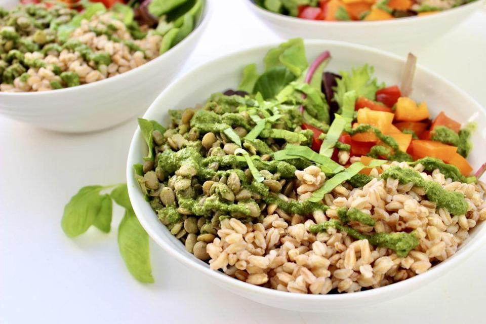 """<p>Farro and lentils make this bowl oh-so filling. Double up on the pesto and use the leftovers all week long.</p><p><a class=""""link rapid-noclick-resp"""" href=""""https://kellyjonesnutrition.com/vegan-grain-bowl/"""" rel=""""nofollow noopener"""" target=""""_blank"""" data-ylk=""""slk:GET THE RECIPE"""">GET THE RECIPE</a> </p><p><em>Per serving: 480 calories, 19 g fat (3 g saturated), 270 mg sodium, 62 g carbs, 16 g fiber, 5 g sugar, 20 g protein</em></p>"""