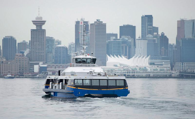 Downtown Vancouver is pictured in the background as a Seabus leaves North Vancouver, B.C. on Wednesday, Feb. 4, 2015. (Photo: Jonathan Hayward/THE CANADIAN PRESS)