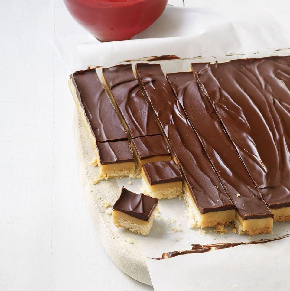 """<p>Like a homemade Twix bar, these bites layer caramel in between crunchy cookie and smooth chocolate.</p><p><em><a href=""""https://www.goodhousekeeping.com/food-recipes/a15184/chocolate-caramel-candy-bars-recipe-wdy0213/"""" rel=""""nofollow noopener"""" target=""""_blank"""" data-ylk=""""slk:Get the recipe for Chocolate Caramel Candy Bars »"""" class=""""link rapid-noclick-resp"""">Get the recipe for Chocolate Caramel Candy Bars »</a></em></p>"""