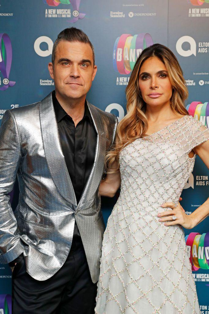 <p>Singer-songwriter Robbie Williams and his actress wife Ayda Field don't just dress alike, they've also nailed the same broody red carpet look. </p>