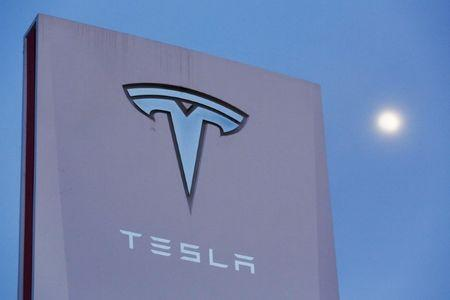 FILE PHOTO: Signage is displayed outside of Tesla Motors before the Tesla Energy Powerwall Home Battery event in Hawthorne, California