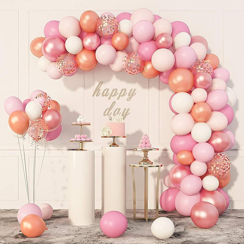 <p>This warm-toned <span>Rose Gold, Coral, and Pink Balloons Garland Arch Kit</span> ($11) will brighten up any environment.</p>