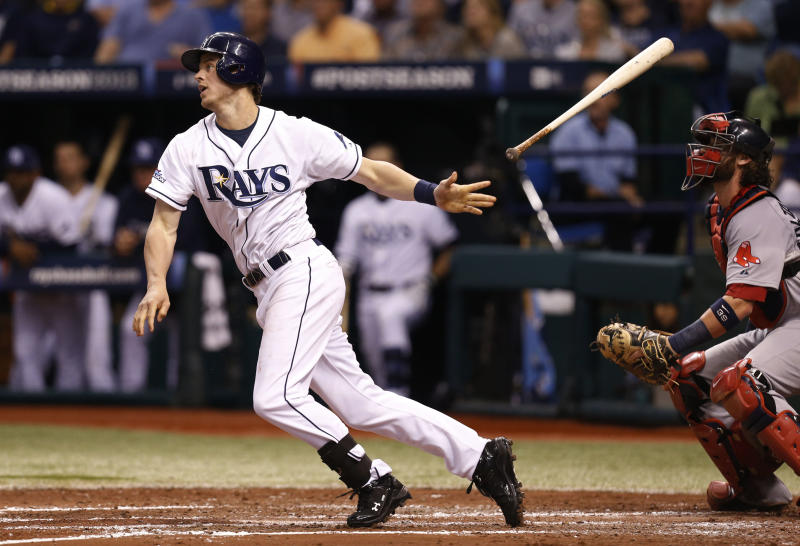 FILE - In this Oct. 8, 2013 file photo, Tampa Bay Rays Wil Myers (9) hits a single in the fourth inning in Game 4 of an American League baseball division series against the Boston Red Sox, in St. Petersburg, Fla. Wil Myers of the Tampa Bay Rays has won the AL Rookie of the Year award after putting up impressive offensive numbers in barely half a season. The right fielder received 23 of 30 first-place votes from the Baseball Writers' Association of America in results announced Monday, Nov. 11, 2013 beating out Detroit shortstop Jose Iglesias and Rays teammate Chris Archer. (AP Photo/Mike Carlson, File)