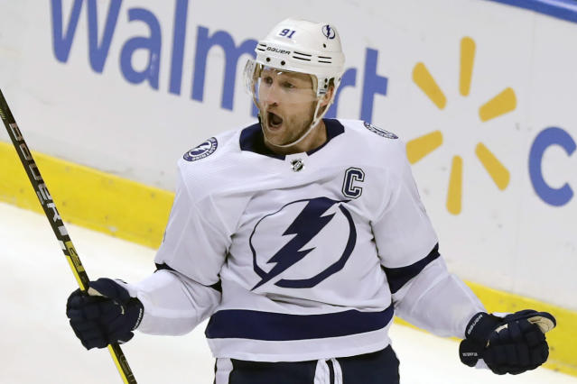 Tampa Bay Lightning's Steven Stamkos (91) reacts after scoring a goal against Florida Panthers goalkeeper Sergei Bobrovsky during the first period of an NHL hockey game, Tuesday, Dec. 10, 2019, in Sunrise, Fla. (AP Photo/Luis M. Alvarez)