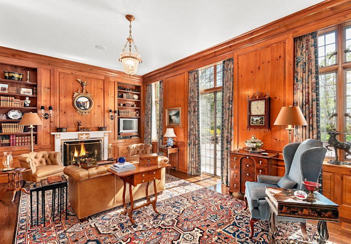 Book lovers will enjoy cozying up in this heart pine-paneled oasis complete with an antique English marble mantel, custom heart pine built-ins, and quarter-sawn oak flooring.