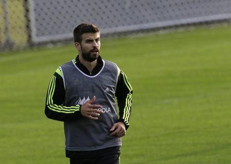 Spain's player Gerard Pique runs during a training session ahead of the 2014 World Cup in Curitiba