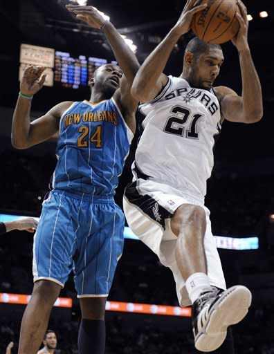 San Antonio Spurs forward Tim Duncan collects a rebound against New Orleans Hornets forward Carl Landry during the second half of an NBA basketball game in San Antonio on Thursday, Feb. 2, 2012. The Spurs beat the Hornets 93-81. (AP Photo/Bahram Mark Sobhani)
