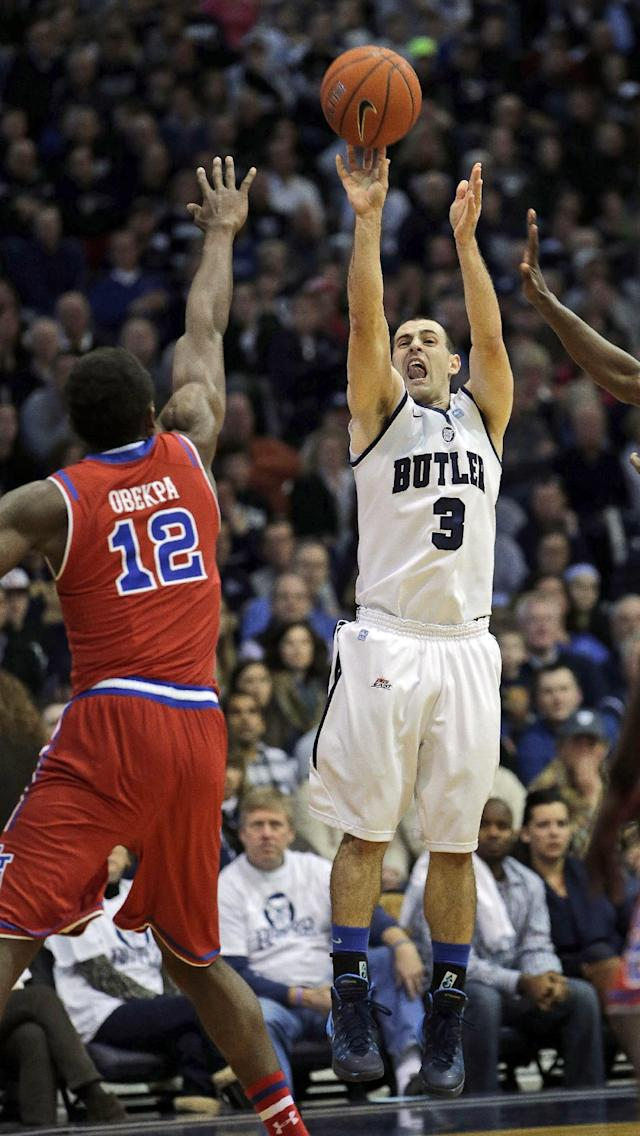 Butler guard Alex Barlow (3) shoots over St. John's center Chris Obekpa (12) during the first half of an NCAA college basketball game, Saturday, Jan. 25, 2014, in Indianapolis. (AP Photo/AJ Mast)